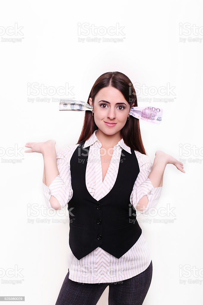 Business lady keeps the money in the ears stock photo
