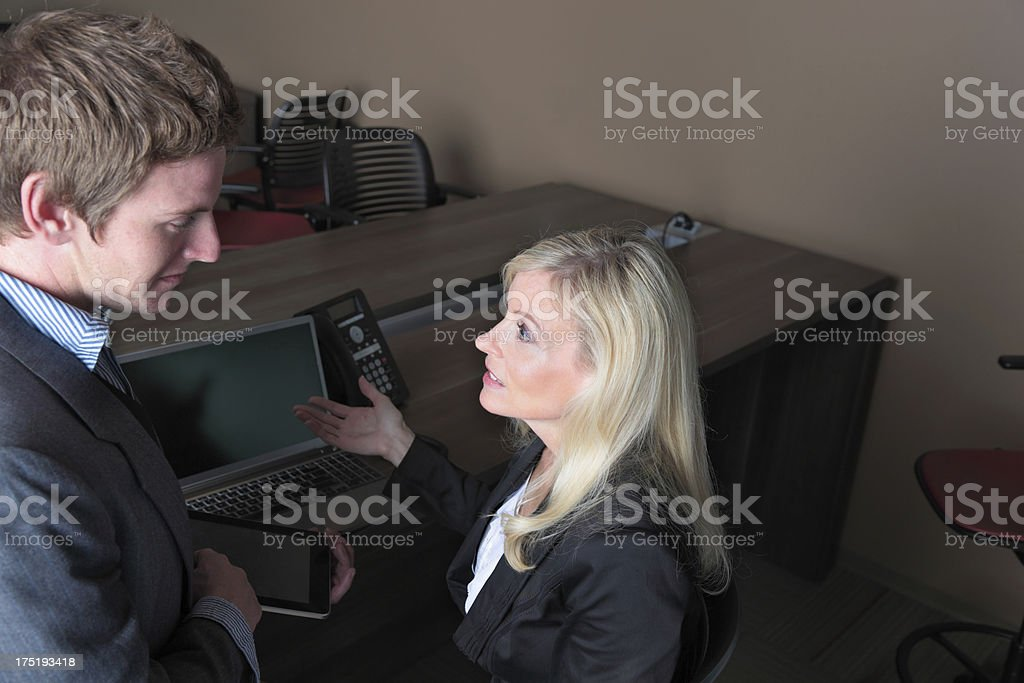 business lady manager shrugs as employee shows digital tablet stock photo