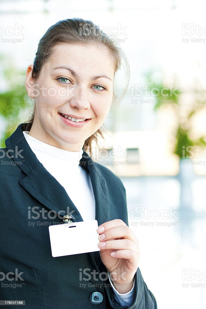 Business lady represents on her Blank ID Badge royalty-free stock photo