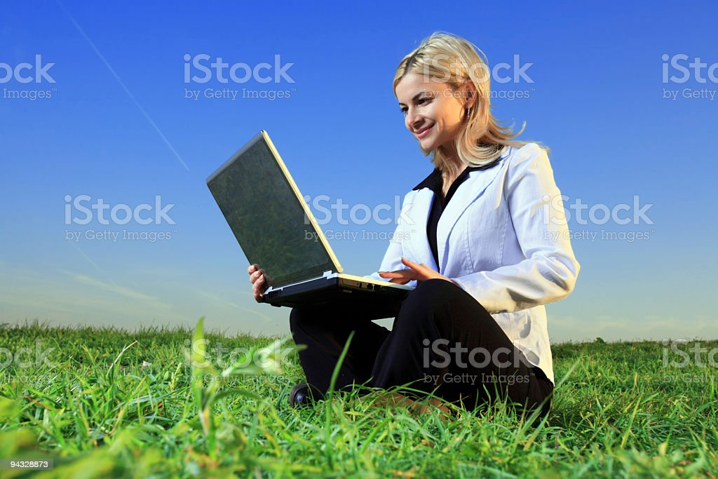 Business lady with laptop outside. stock photo