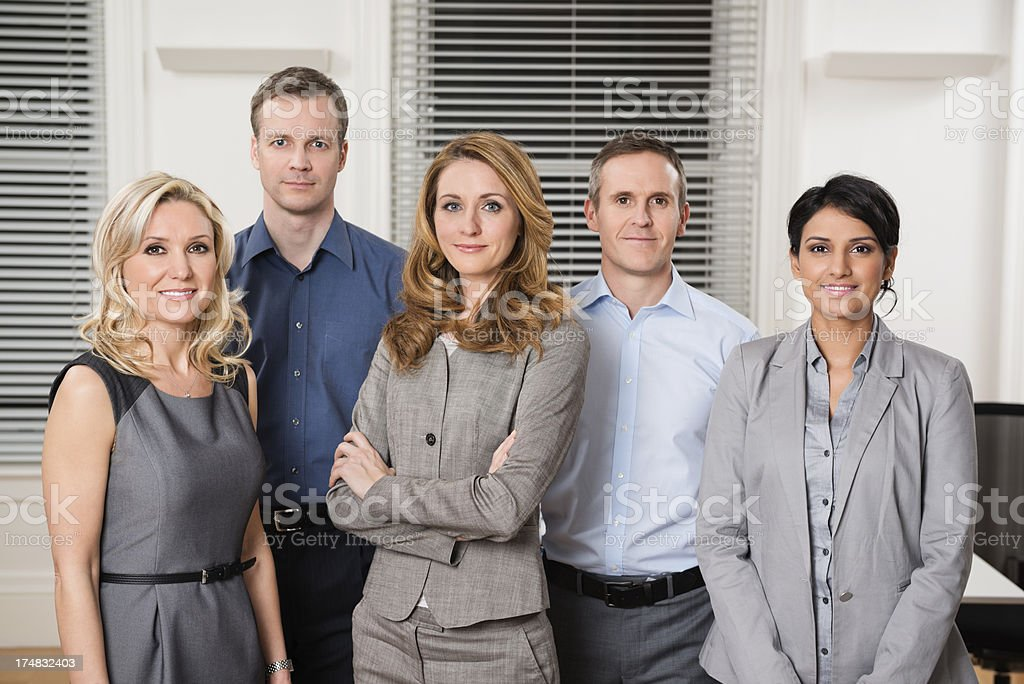 Business Leader Standing With Her Team royalty-free stock photo