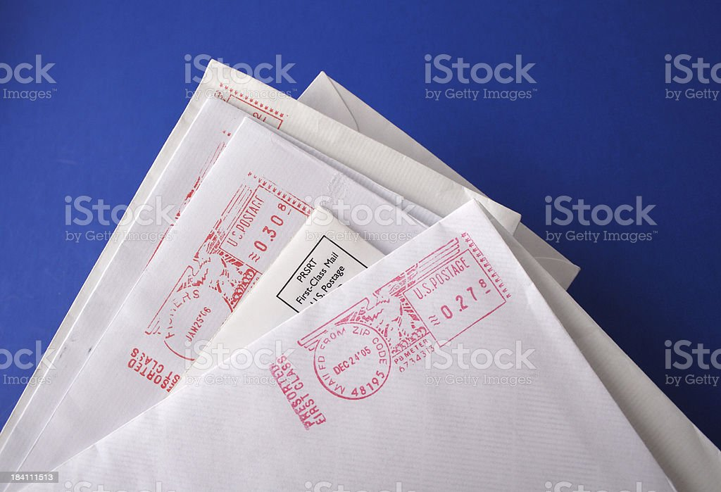 Business letters on blue background stock photo
