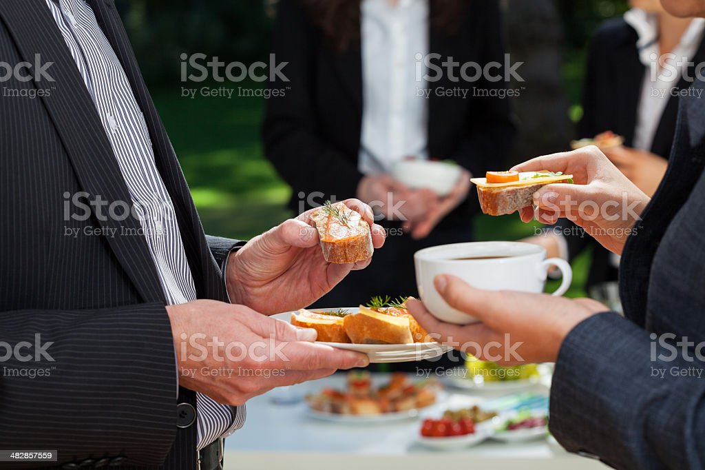 Business lunch in the garden stock photo