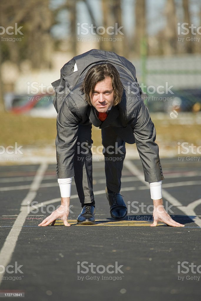 Business man about to run on track royalty-free stock photo