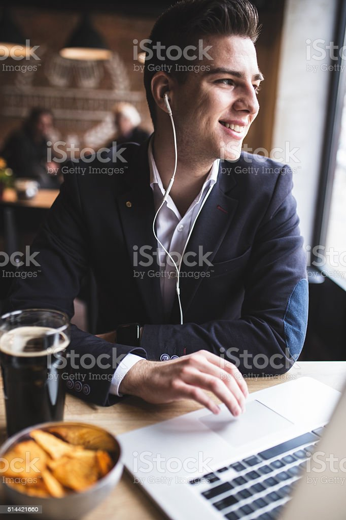 Business man abroad Skyping with his colleagues, great news. stock photo