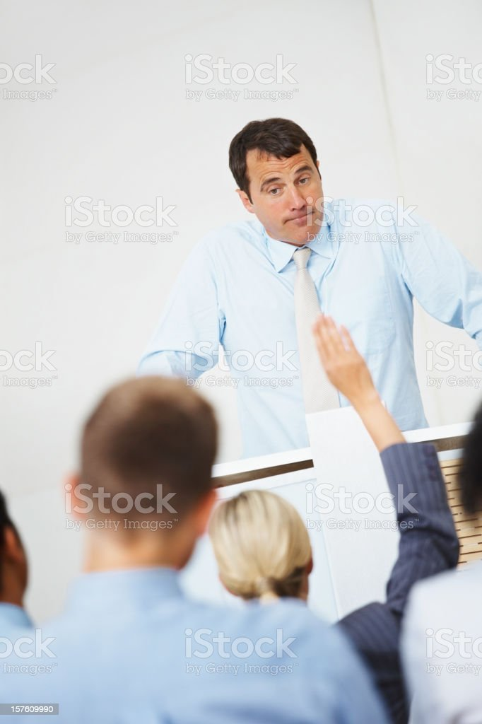 Business man addressing a group of journalist royalty-free stock photo