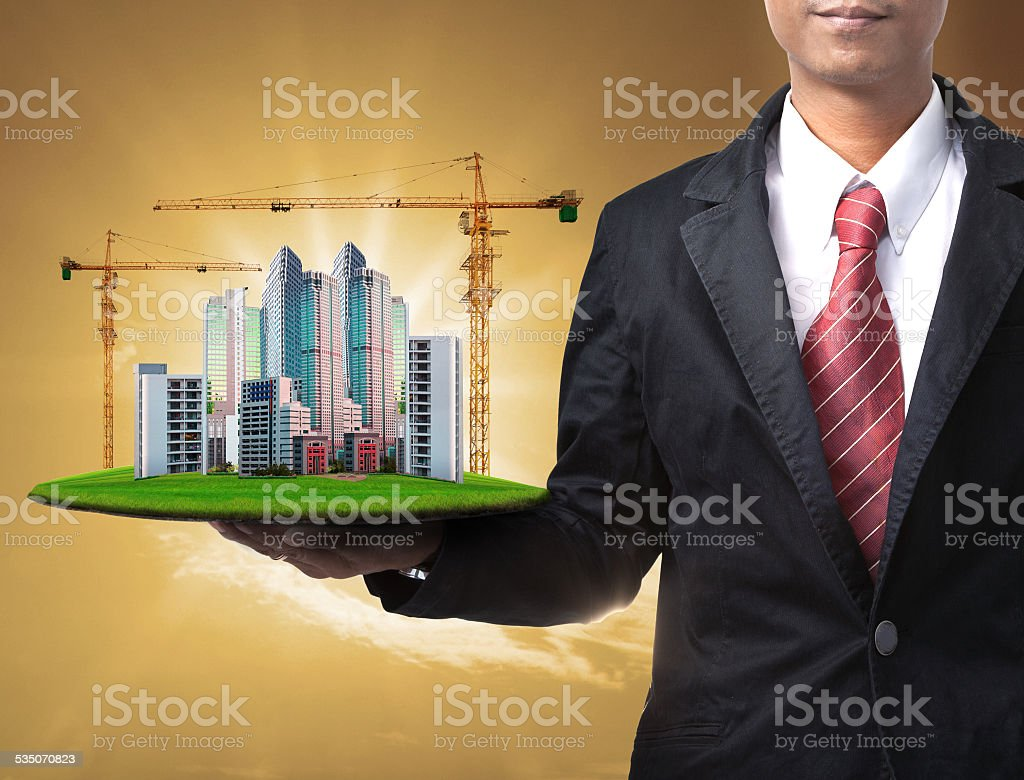 business man and building construction stock photo