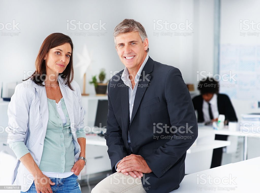 Business man and business woman at the office stock photo