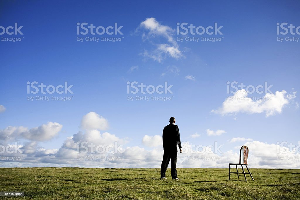 Business man and chair stock photo