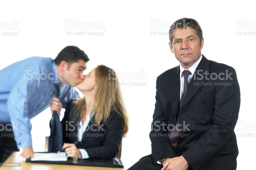 Business Man and his Team Misbehaving Behind Him stock photo