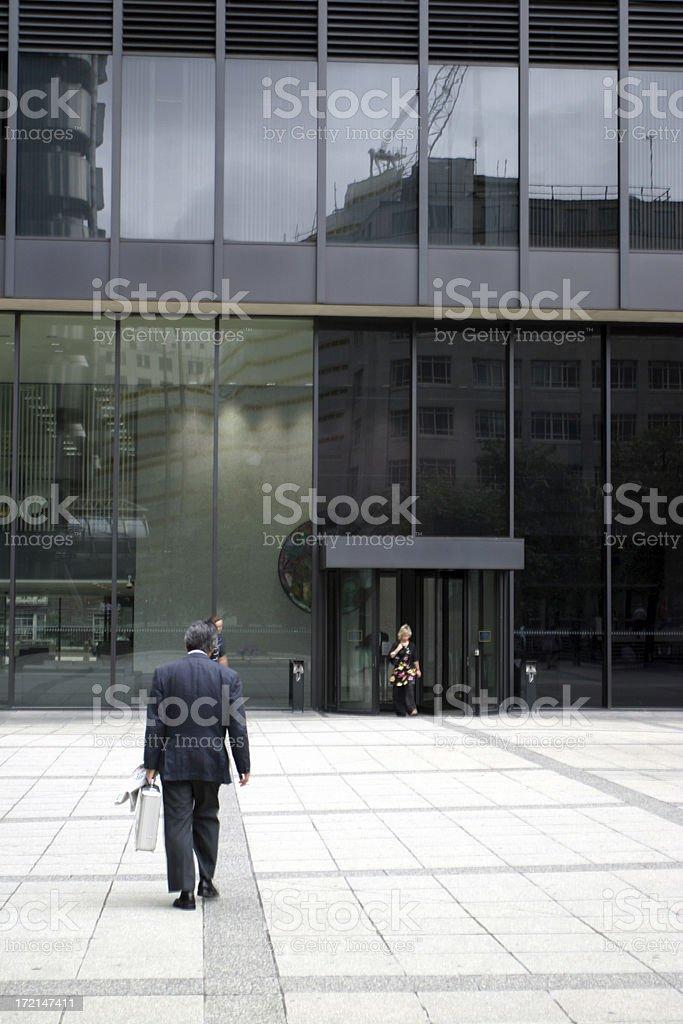 Business man and office building royalty-free stock photo