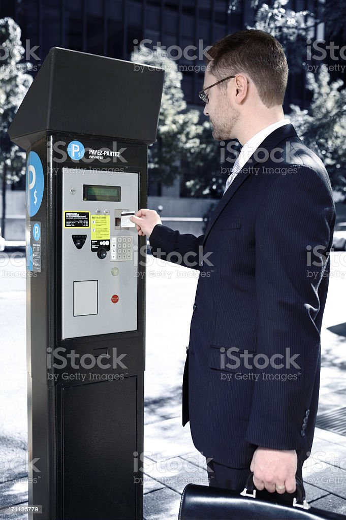 Business man and parking meter. stock photo