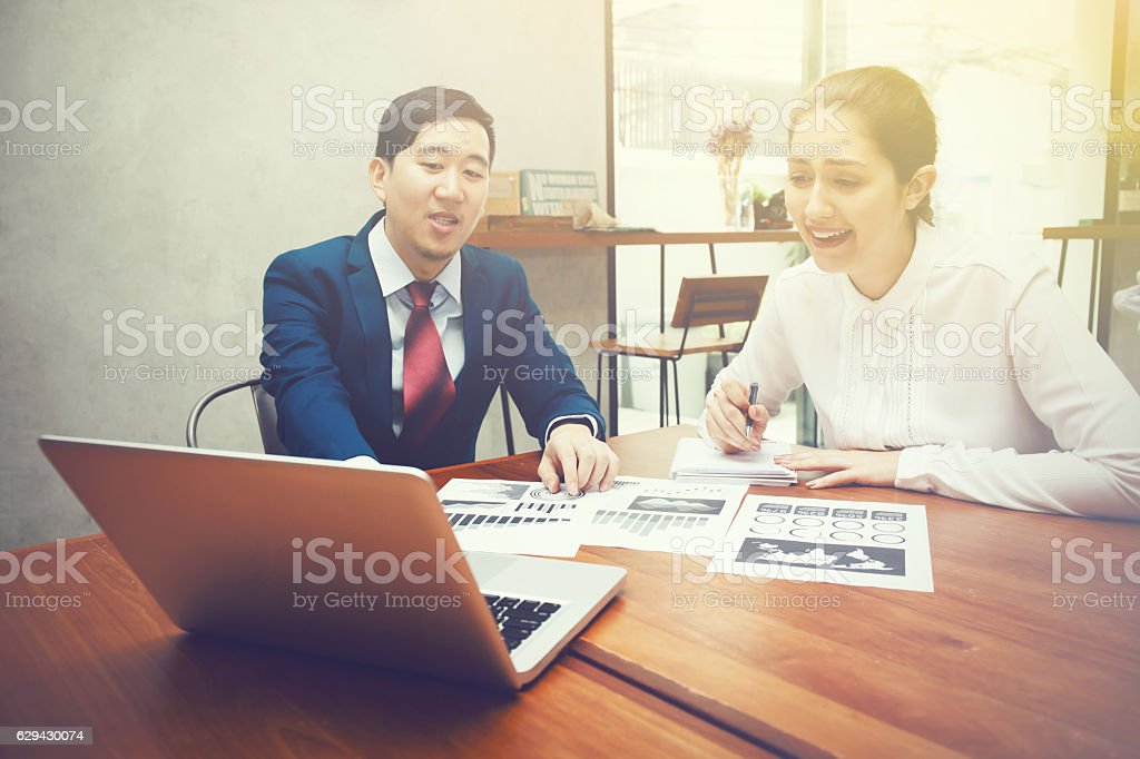 Business man and Surprising Business woman having discussion in stock photo