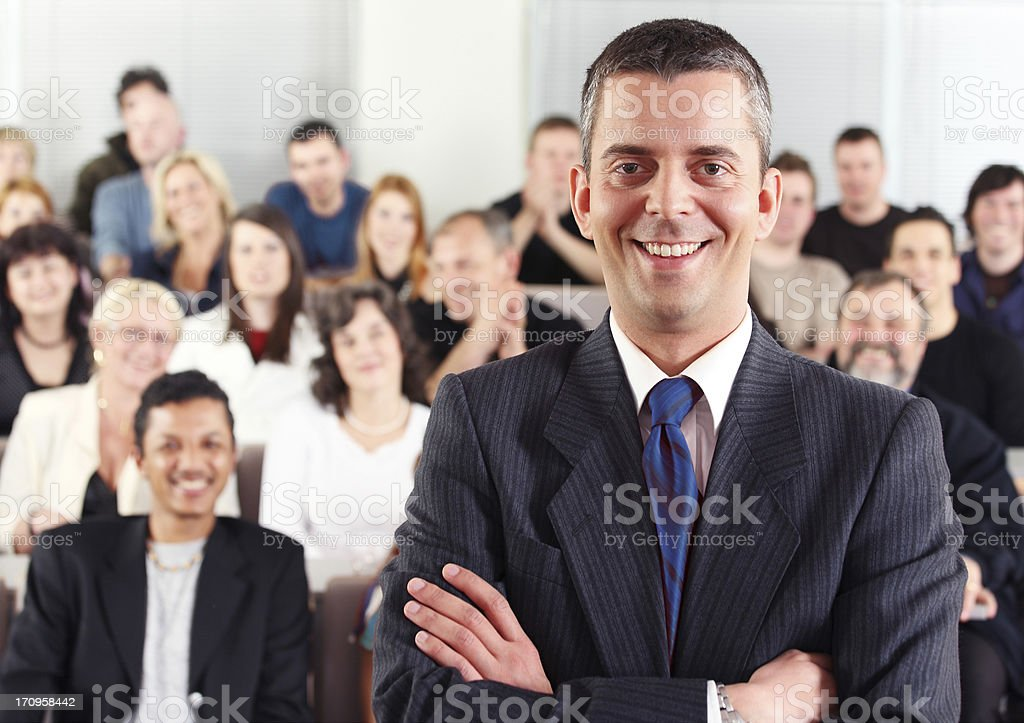 Business man and the audience at conference royalty-free stock photo