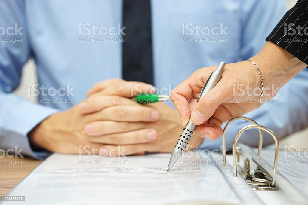business man and woman checking proposal of contract stock photo