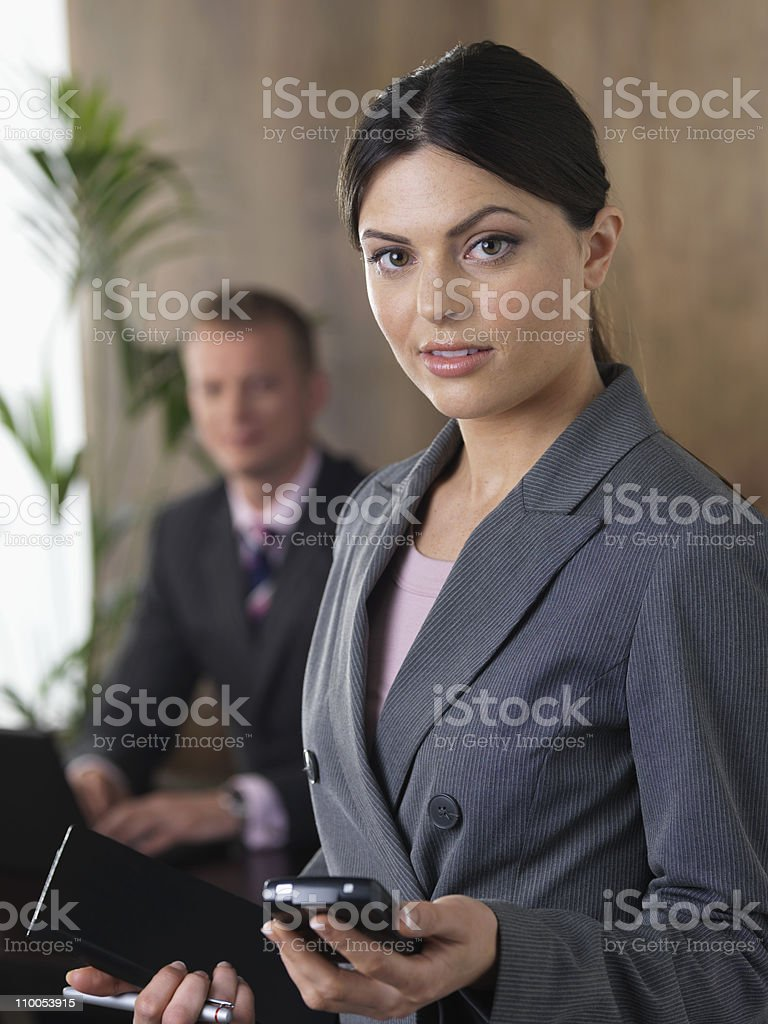 Business man and woman in office stock photo