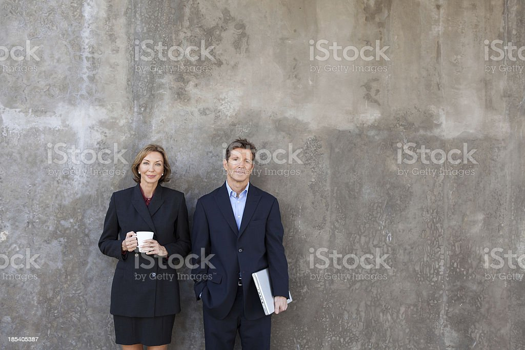 Business man and woman smiling royalty-free stock photo