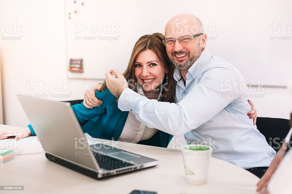Business man and woman taking in an office royalty-free stock photo