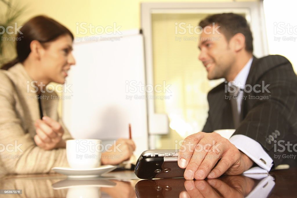 Business man and woman talking in the office royalty-free stock photo