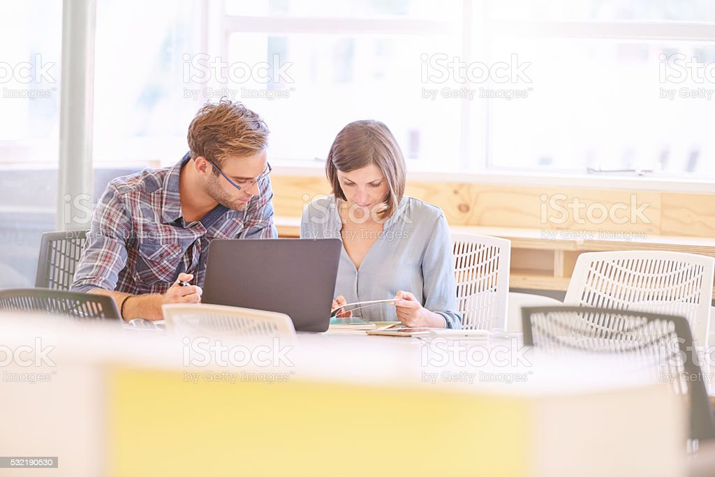 business man and woman working together with copy space stock photo