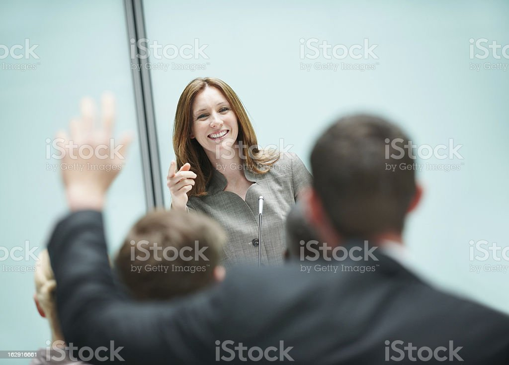 Business man asking question during seminar royalty-free stock photo