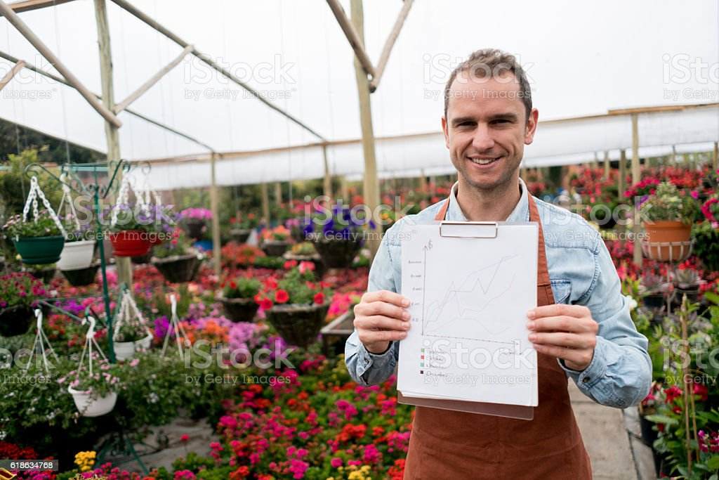 Business man at a greenhouse stock photo