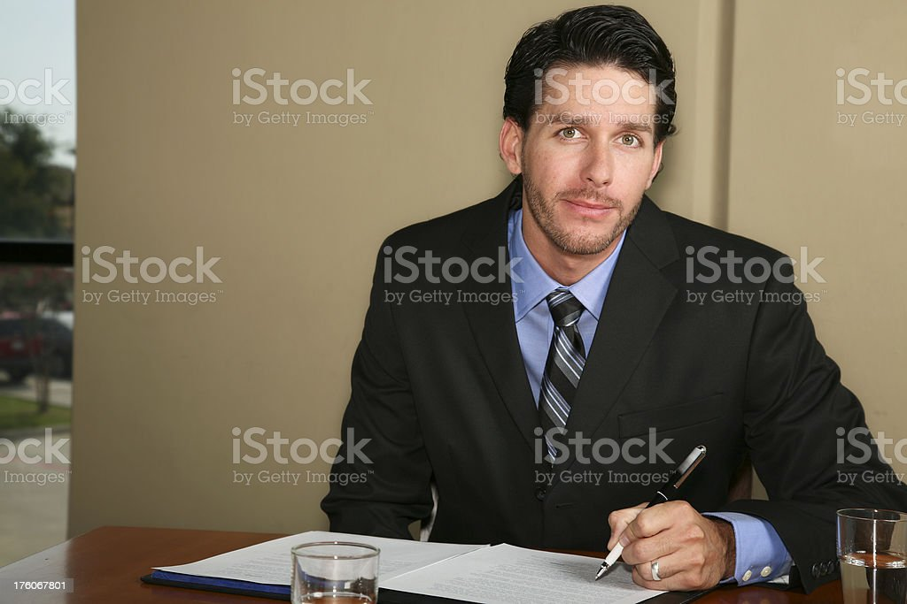 Business Man at Desk Writing royalty-free stock photo
