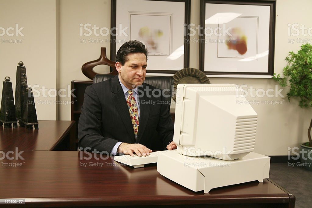 Business man at his desk royalty-free stock photo