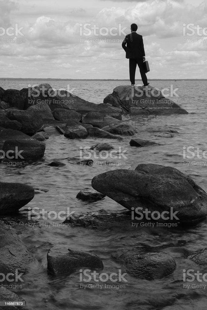 business man at lake's edge stock photo