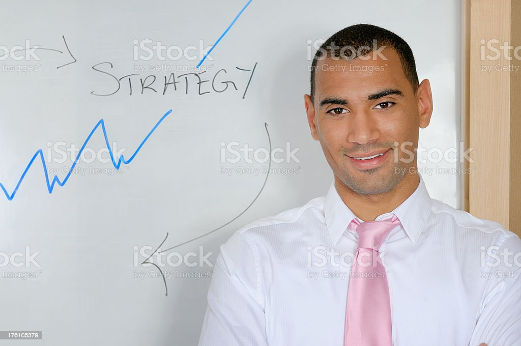 Business man at the white board royalty-free stock photo