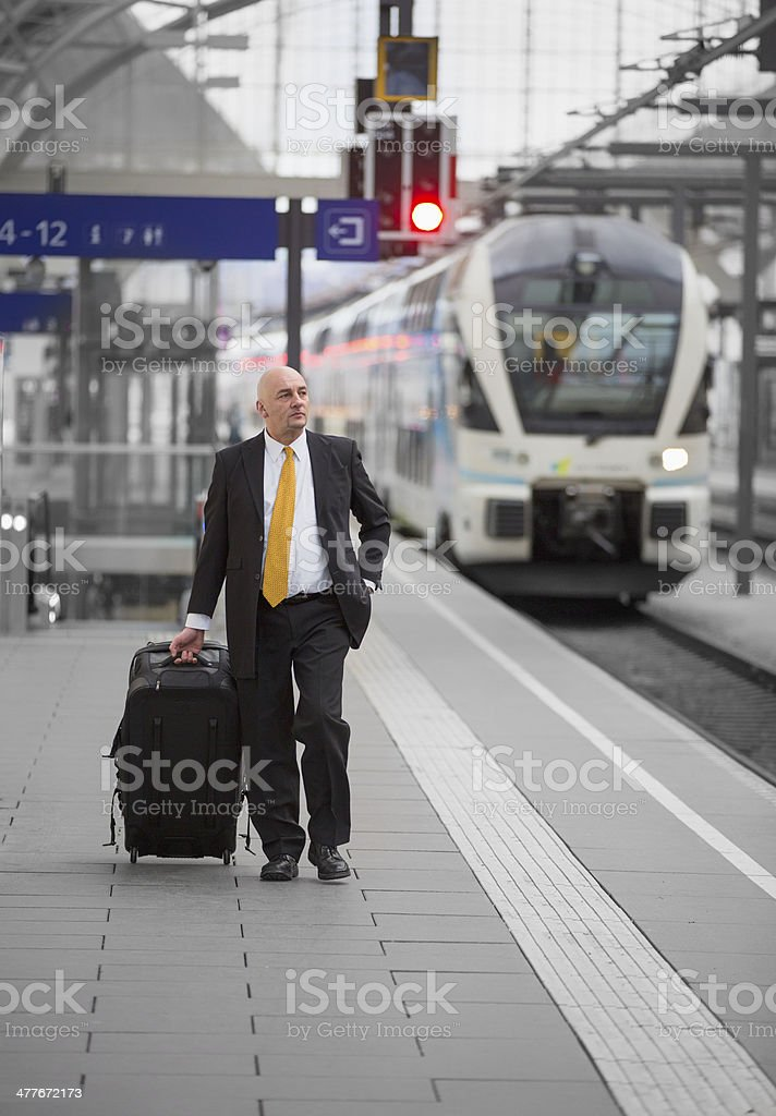 business man at train station royalty-free stock photo