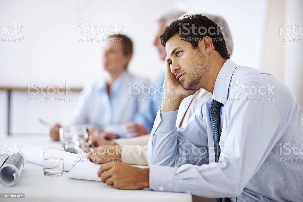 Business man bored during meeting stock photo