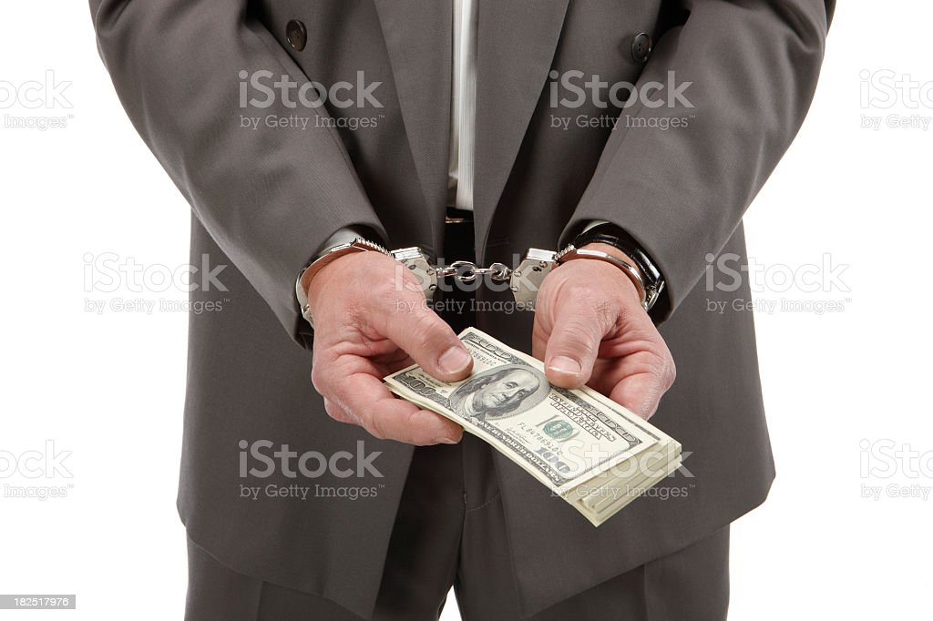 Business man buying his way out stock photo