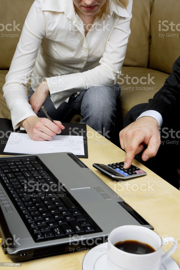 business man calculating profit royalty-free stock photo