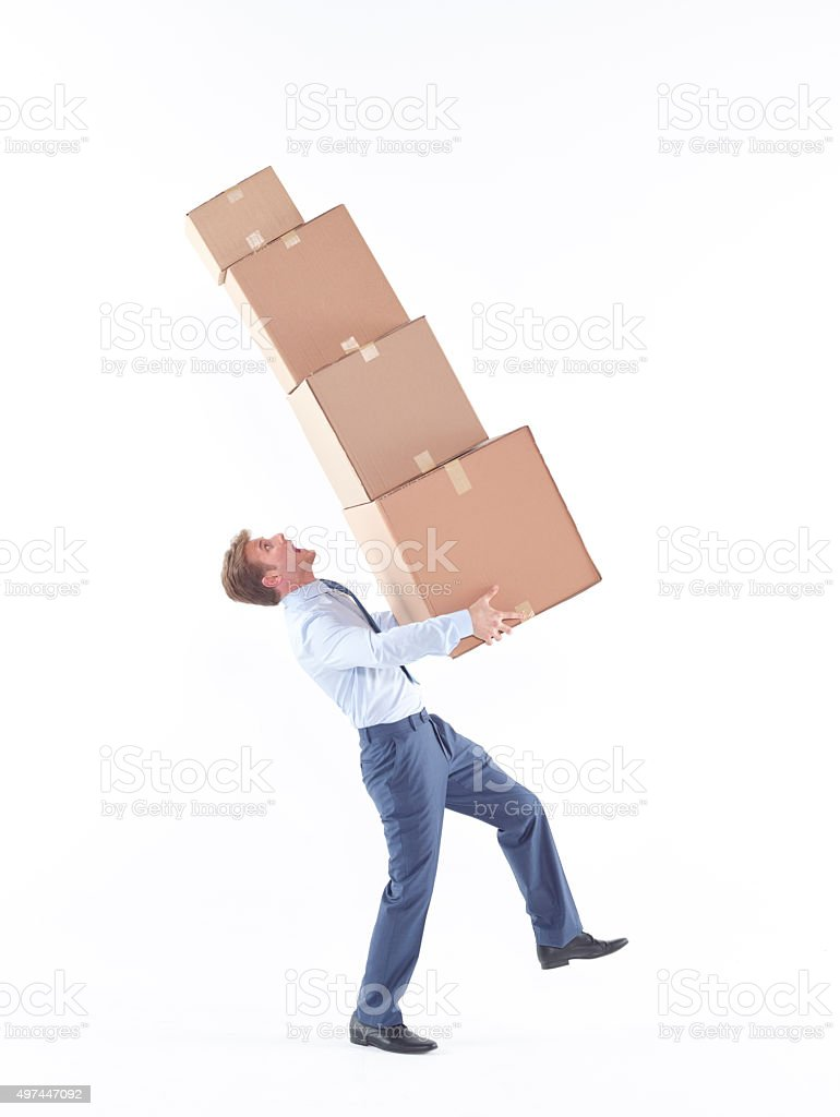 Business man carrying cardboard boxes stock photo