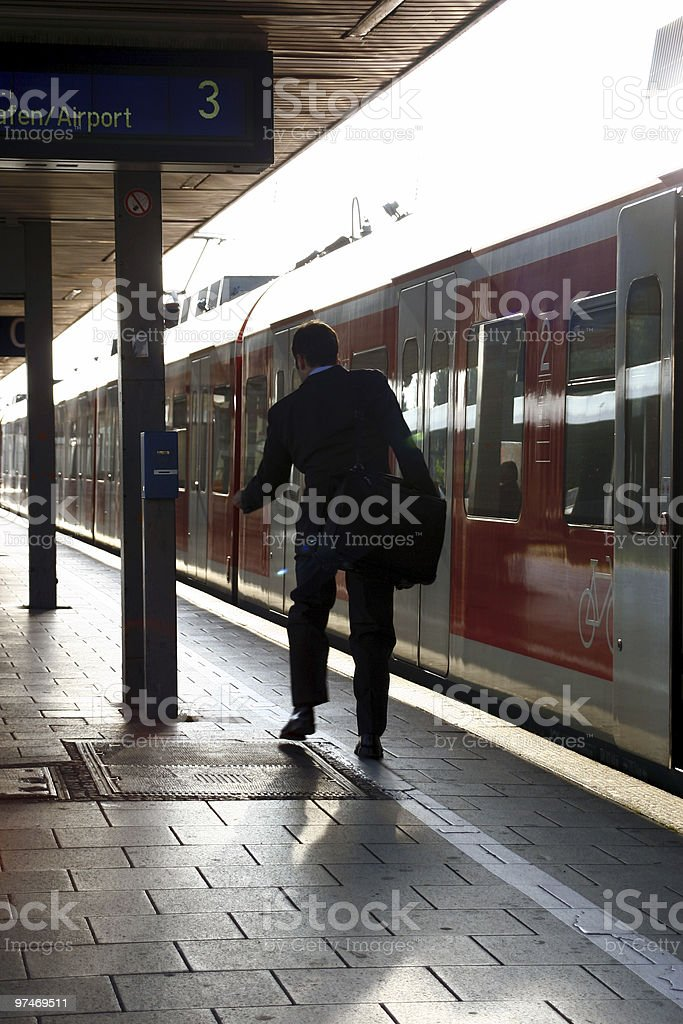 business man catching train royalty-free stock photo
