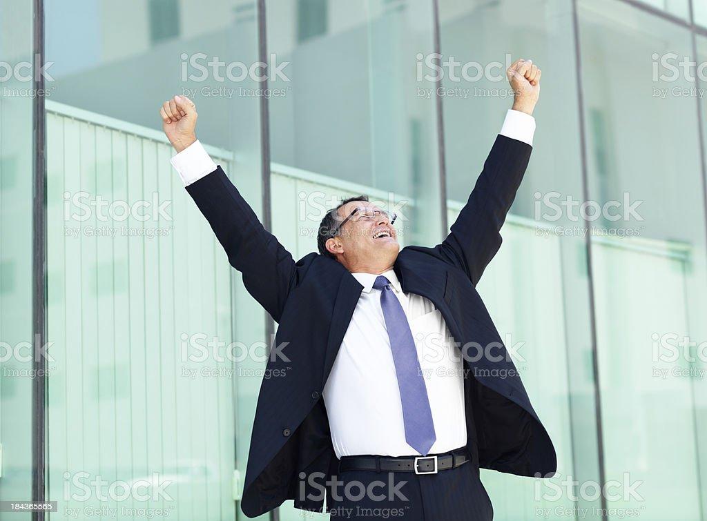 Business man celebrating royalty-free stock photo