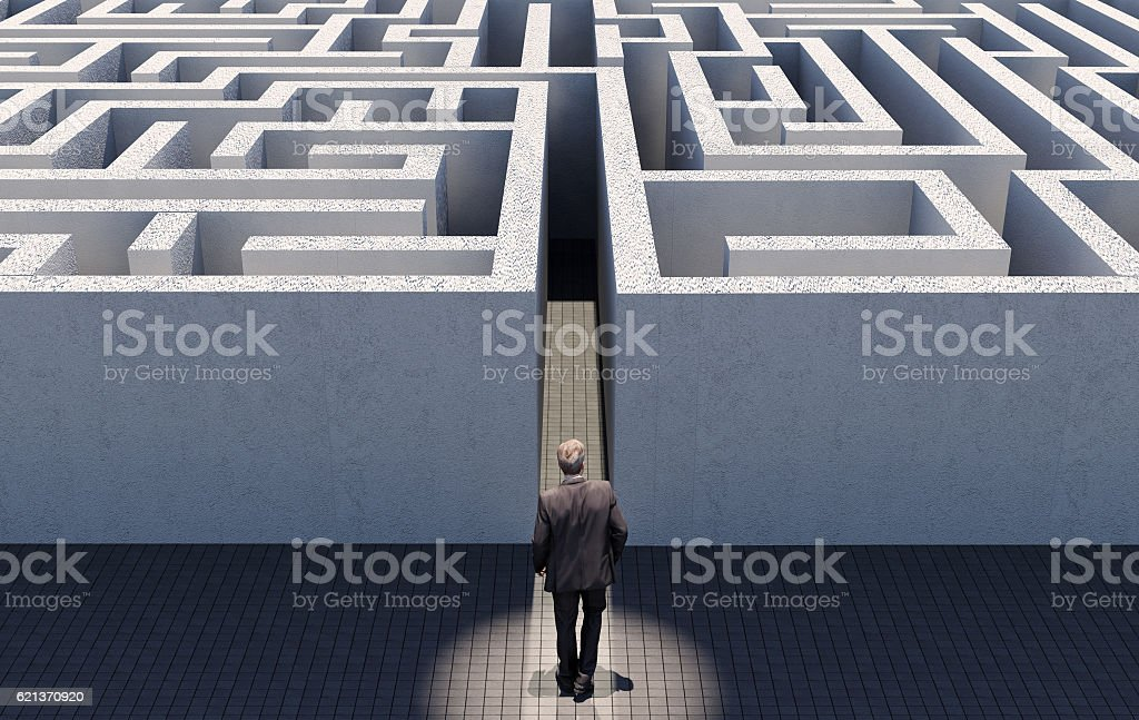 Business man challenge endless maze, business strategy concept stock photo