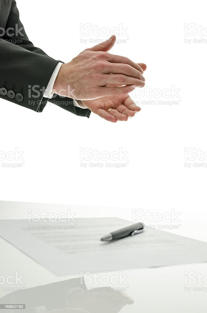 Business man clapping over a signed contract royalty-free stock photo