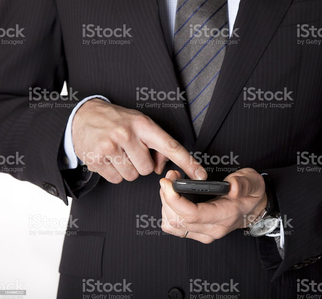 Business man communicating with the smartphone royalty-free stock photo