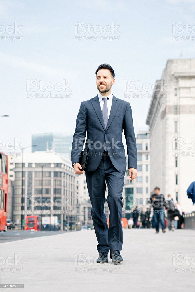 Business Man Commuting To Work, Cityscape On The Background stock photo