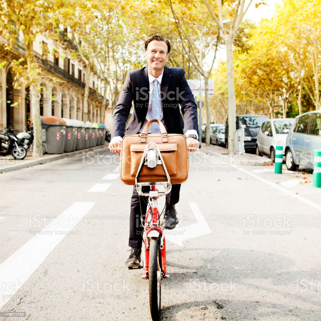 Business man cycling royalty-free stock photo