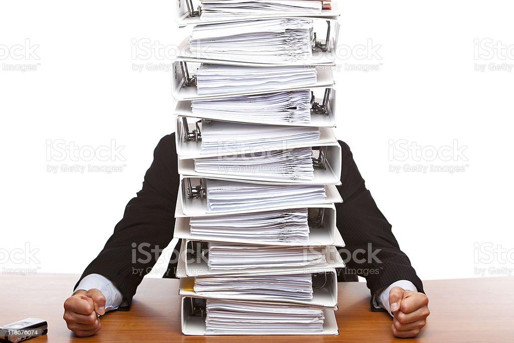 Business man depressed by paperwork (folders) stock photo