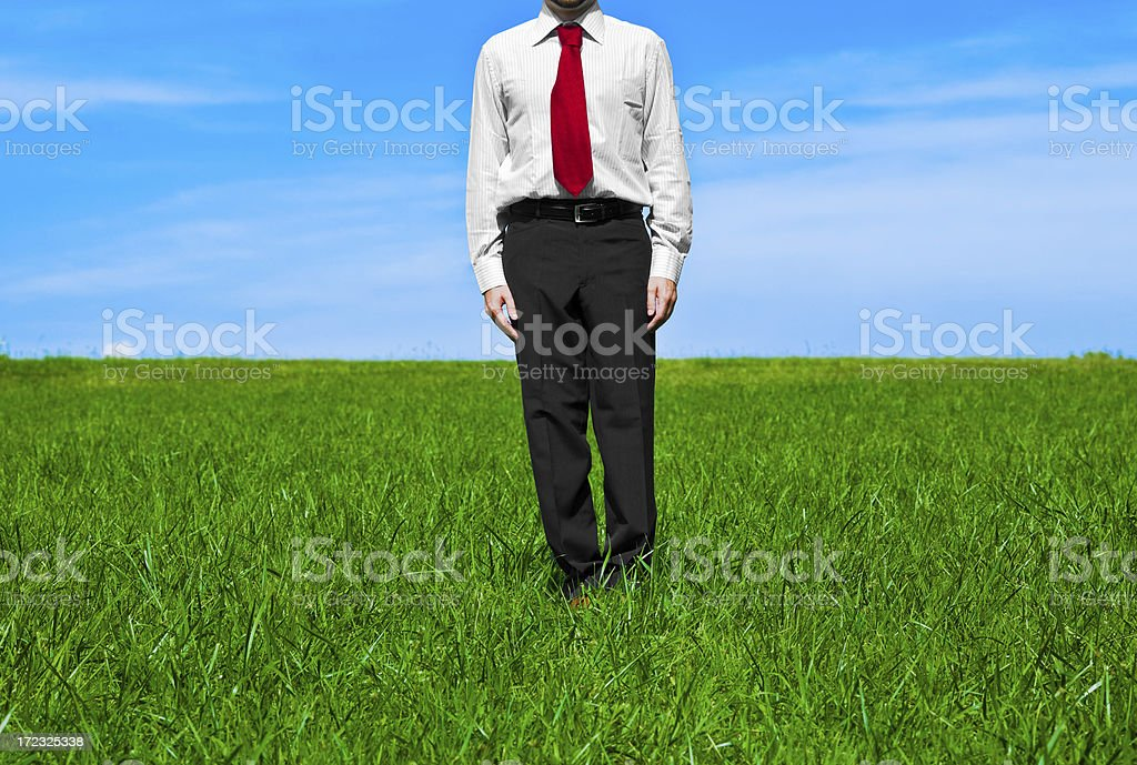 business man detail on spare time in grass field stock photo