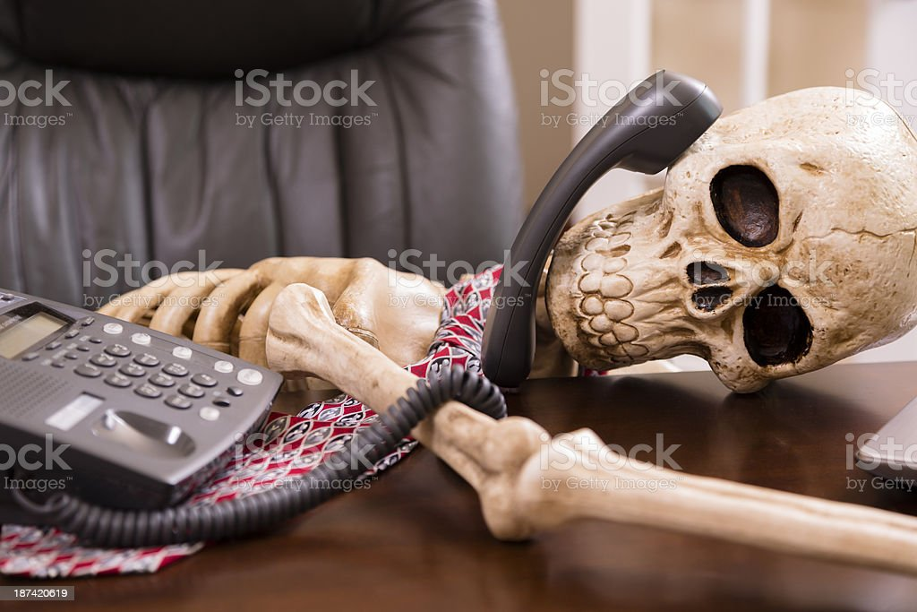 Business: Man died while waiting 'on hold.'  Office phone. stock photo