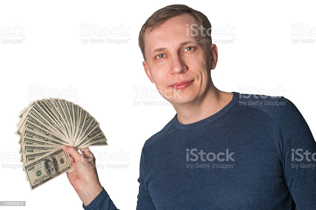 Business Man Displaying a Spread of dollars stock photo