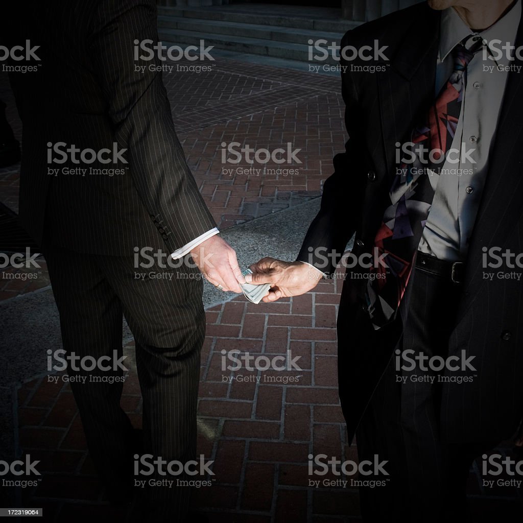 Business man doing secret business royalty-free stock photo
