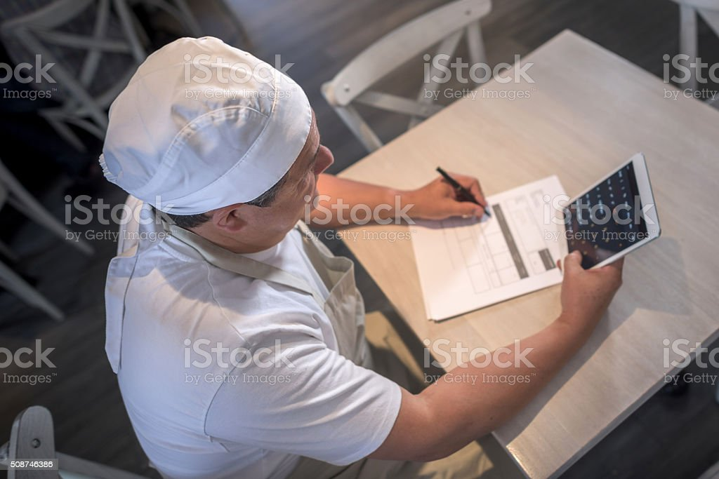 Business man doing the books at a cafe stock photo