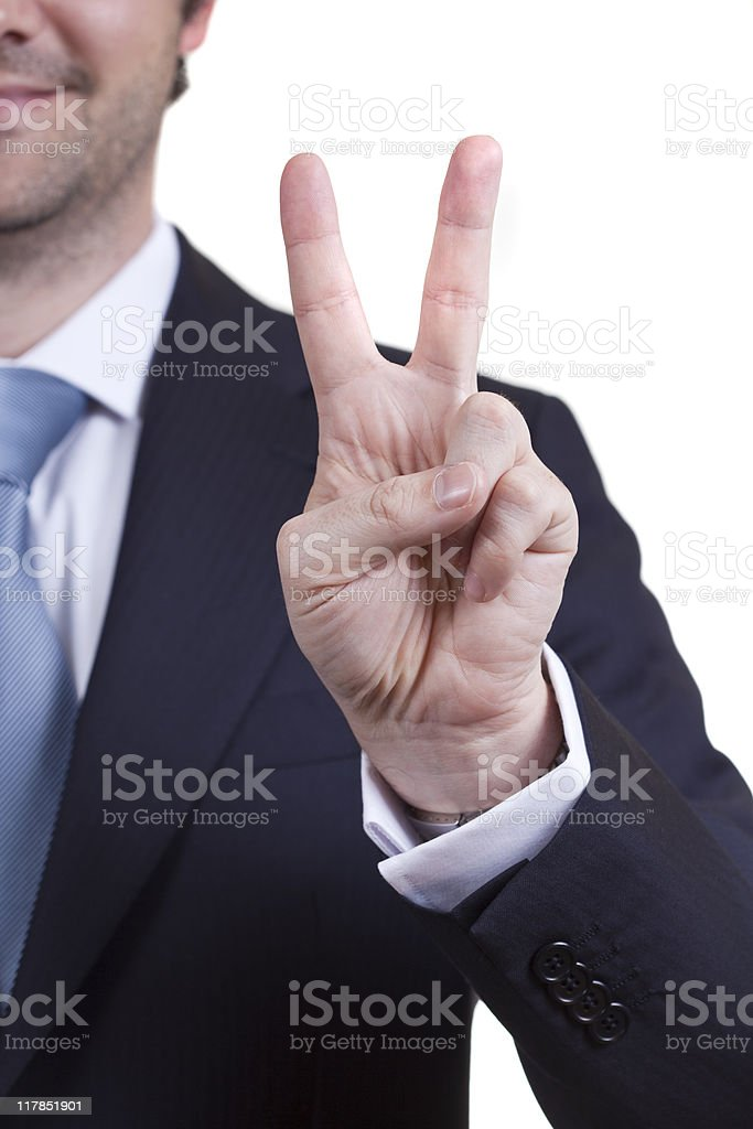 Business man doing the peace sign royalty-free stock photo