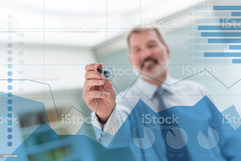 Business man drawing a statistics graph stock photo